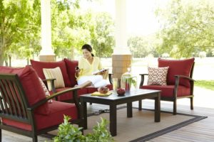 Woman sitting in her outdoor patio