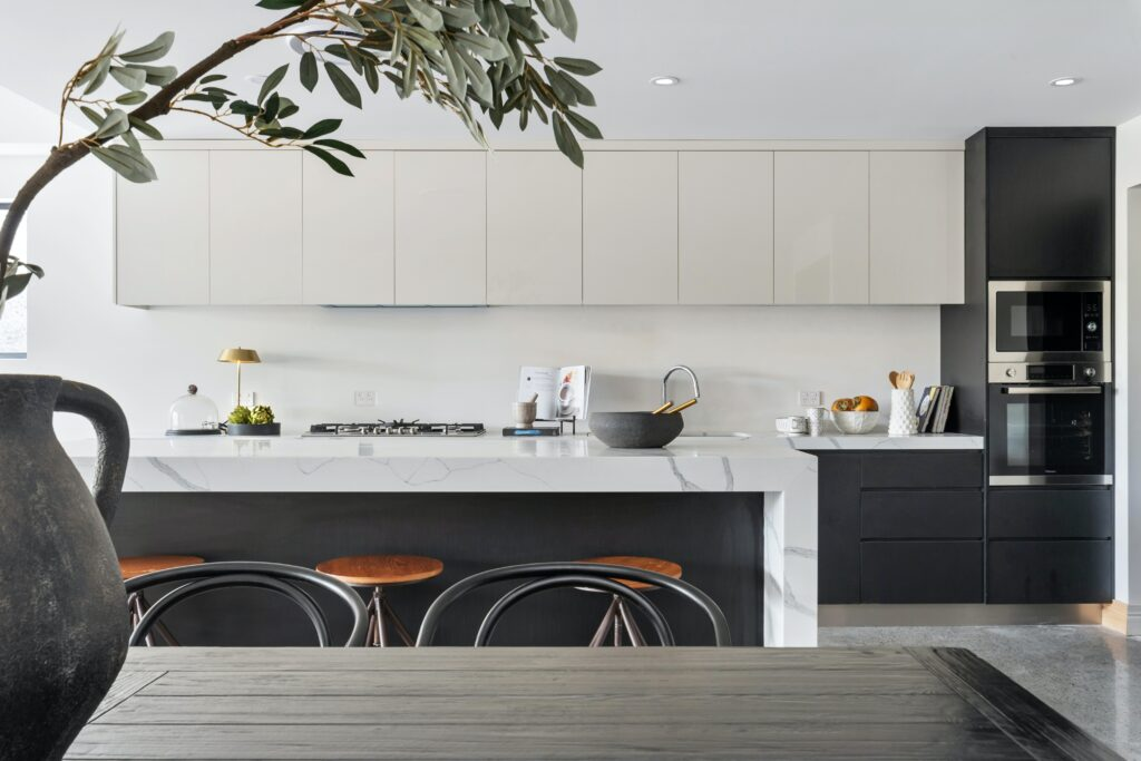 Kitchen area with black and white toned cabinets