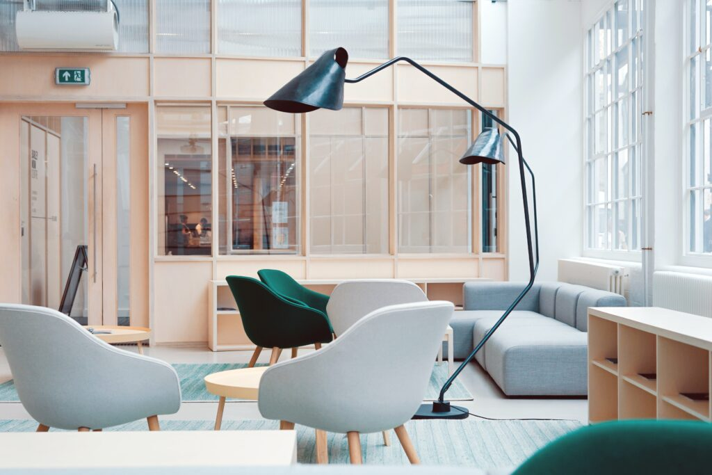 Furniture with lights above two white chairs