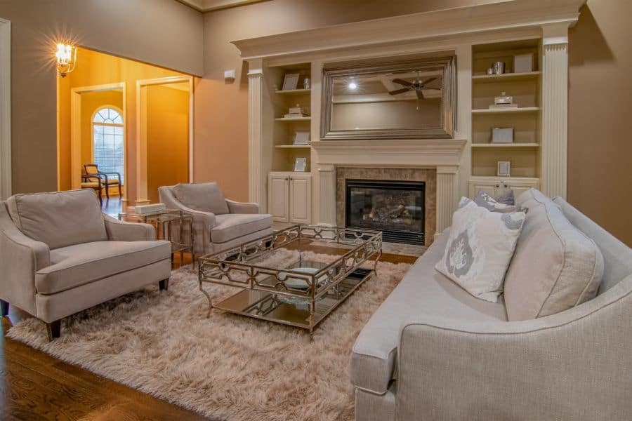 Sofa set in living room with fireplace