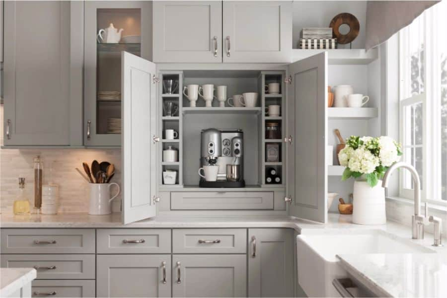 Unlocked kitchen cabinet displaying its contents
