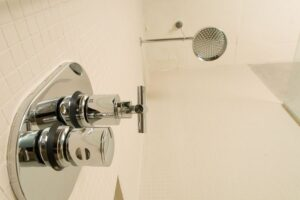 Low angle view of shower fixture in bathroom