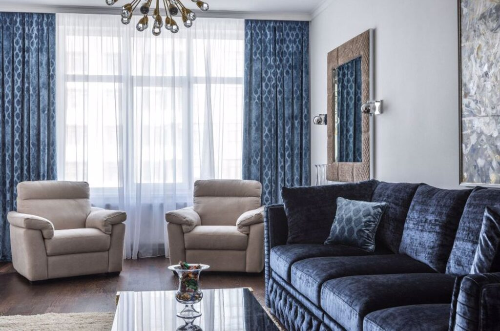 Cindy Crawford blue sofa with 2 gray lounge chairs