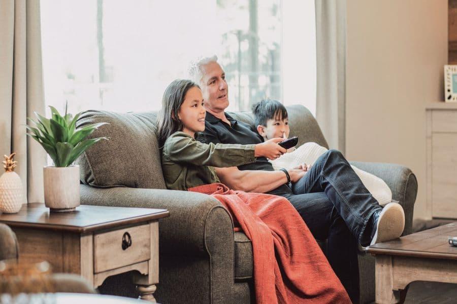 Family sitting on a Flexsteel sofa