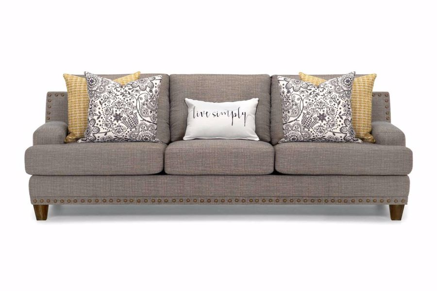 Brown Franklin sofa with throw pillows