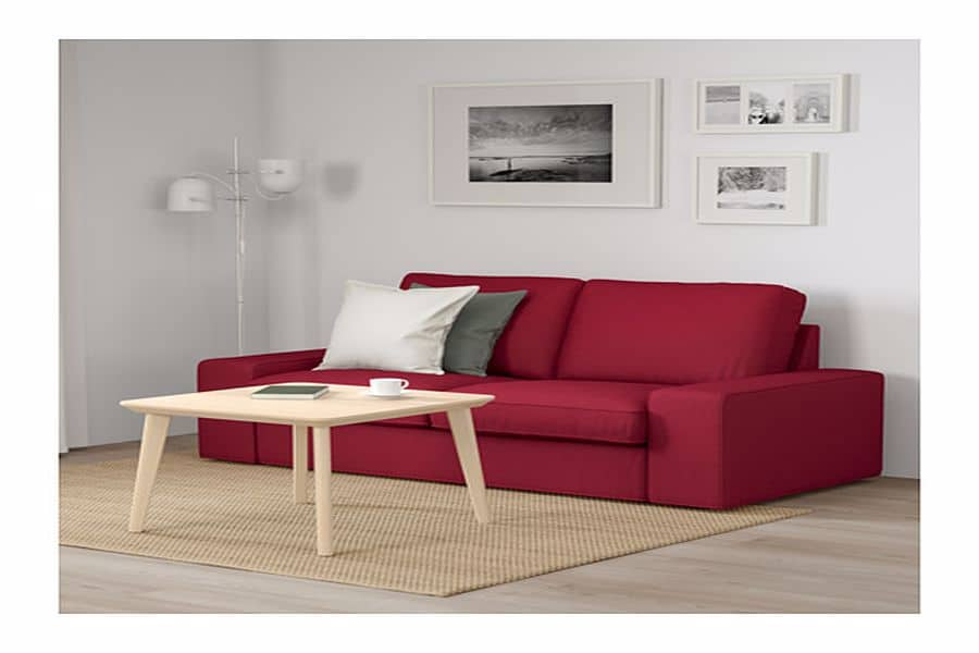 Red sofa with throw pillows