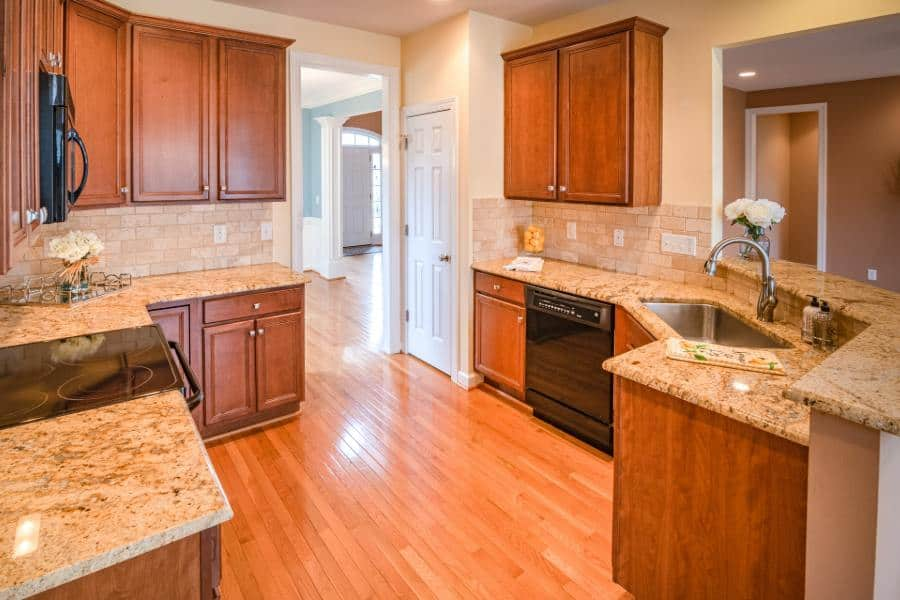 Kitchen with Aristokraft cabinets and granite countertops