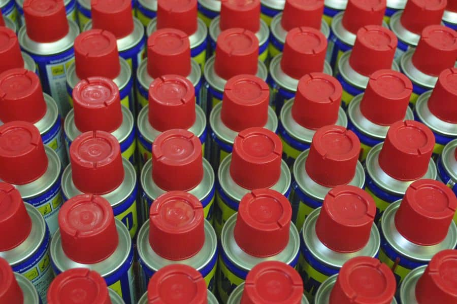 WD 40 lubricant oil cans lined up in storage