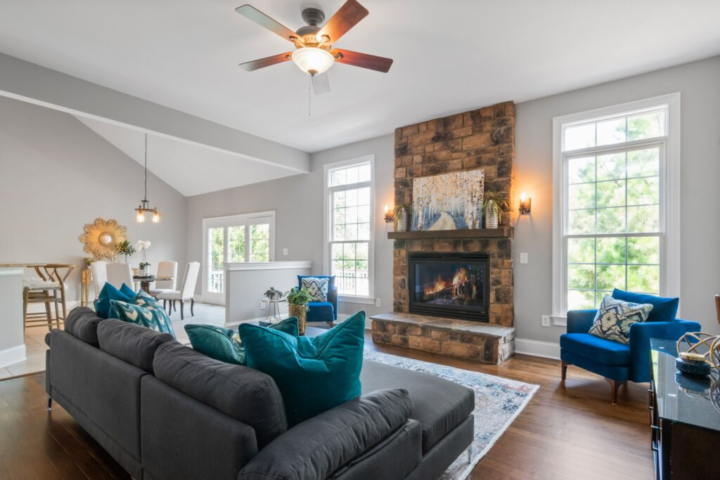 Living room with gray sofa and blue chair