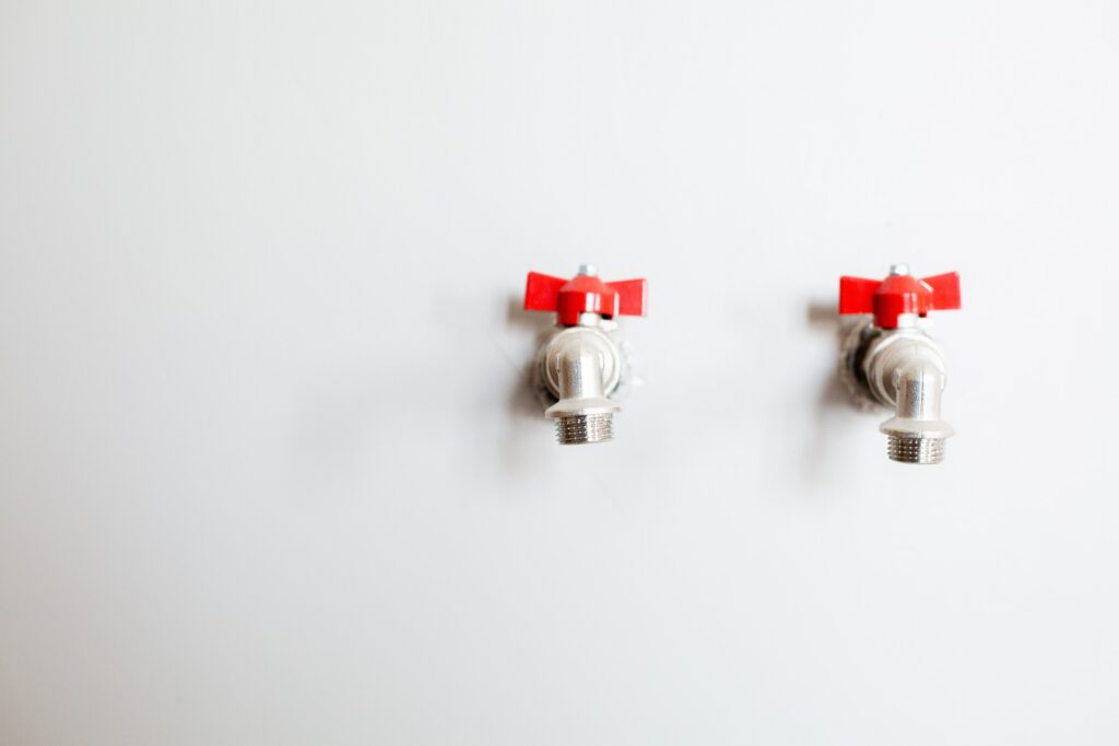 Photo of Faucets on White Wall