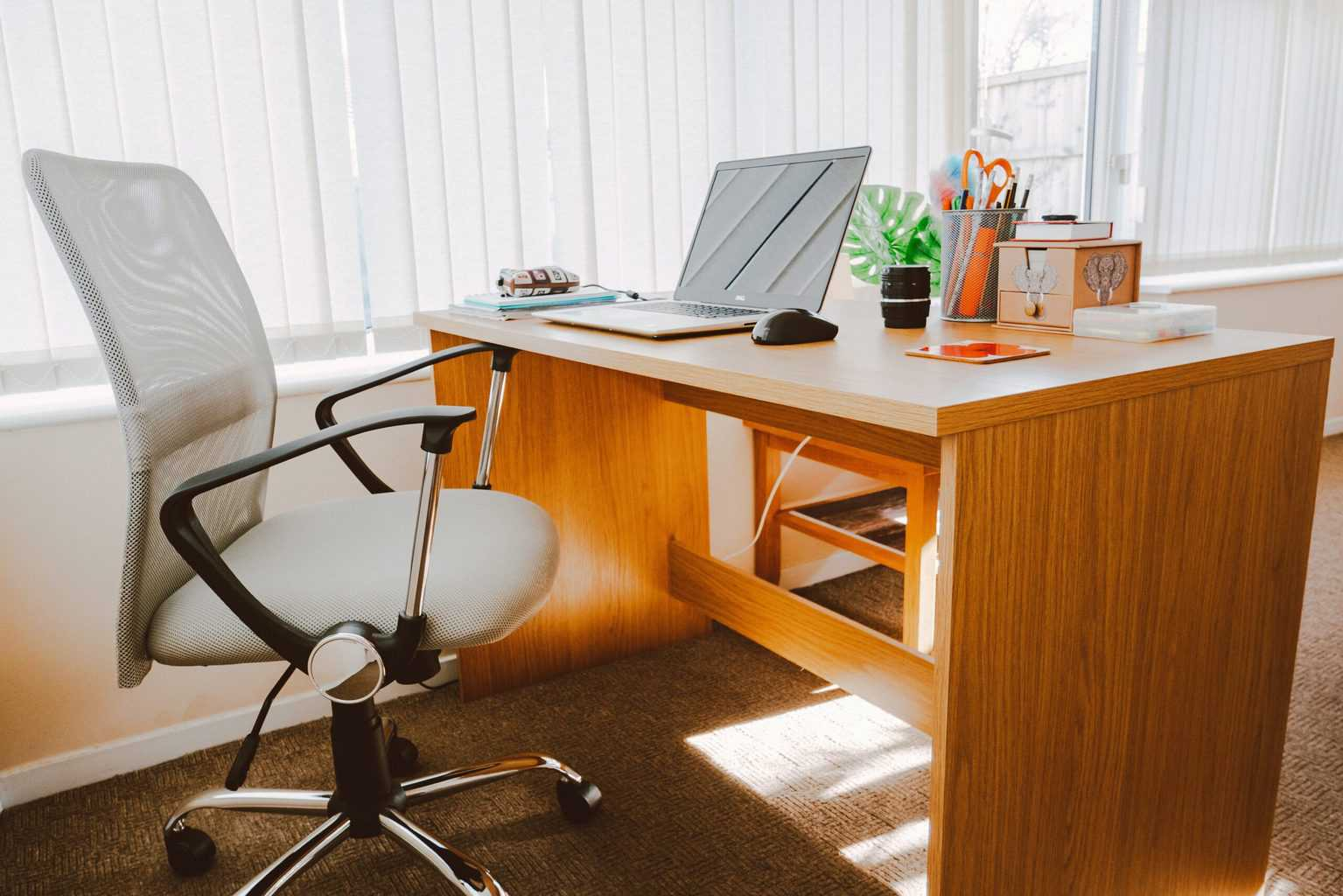 Office chair with laptop on desk