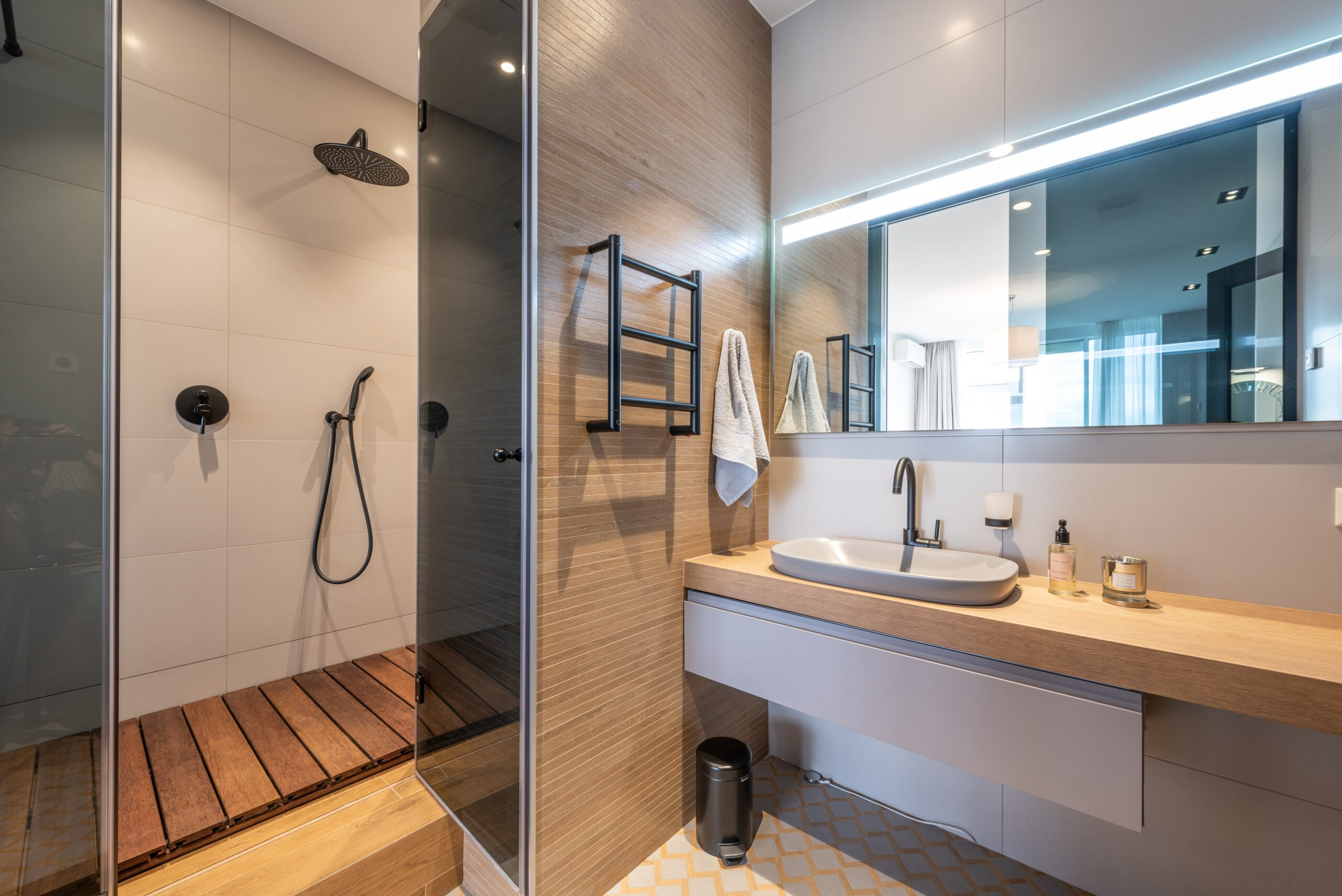 Vanity bathroom with shower and mirror