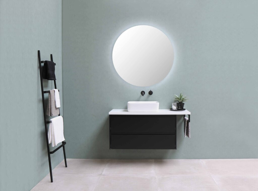 Vanity bathroom with round mirror and sink