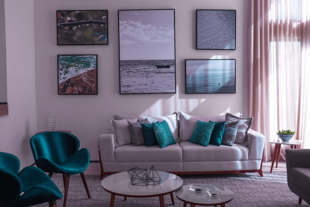 Living room furniture with blue green tone pillows and chairs