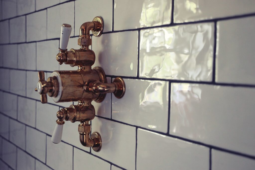 A close up shot of switches against wall tiles