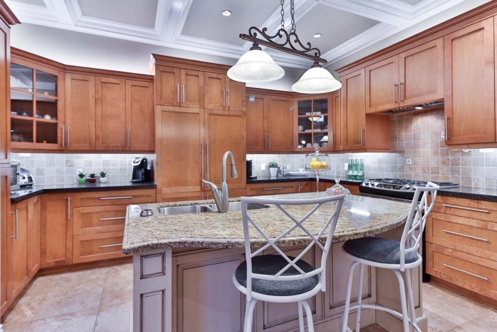 A kitchen and dining area with chairs and wooden cabinets