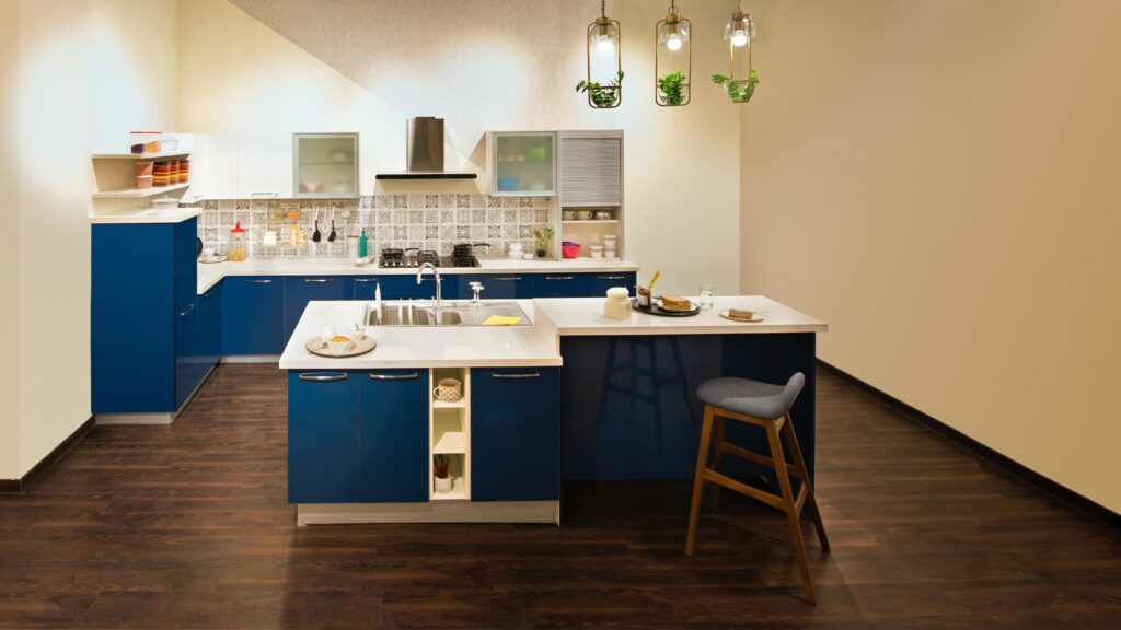 A kitchen and dining area with a blue toned cabinets