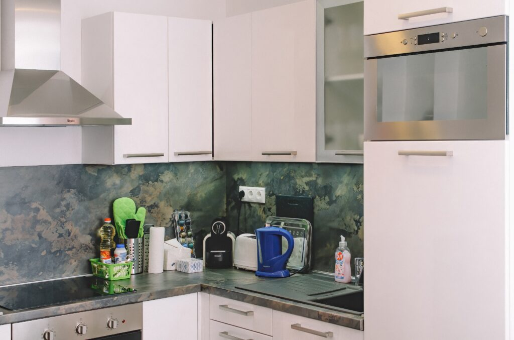 White toned cabinets in the kitchen area