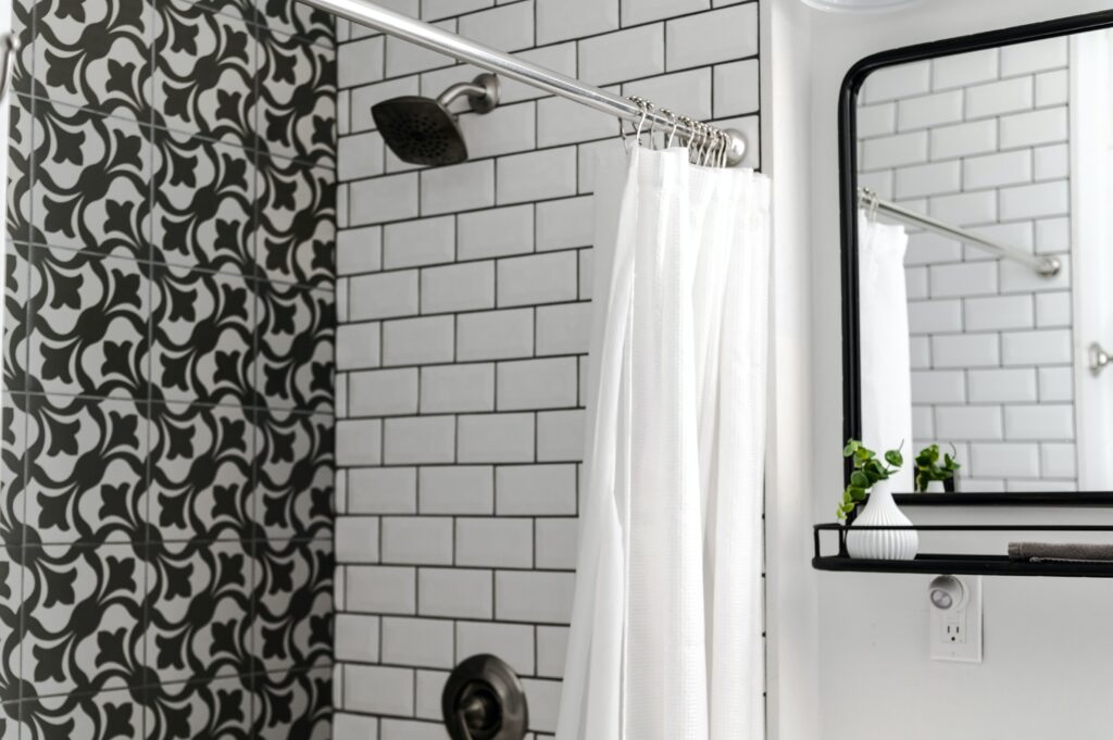bathroom with shower and a mirror