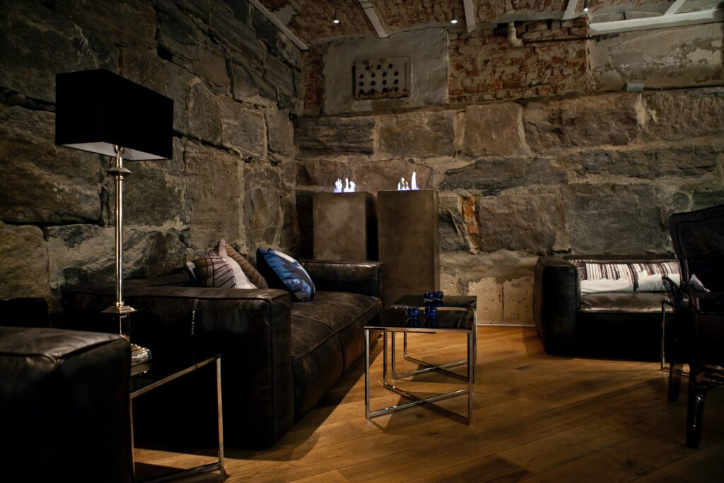 Living room with stone walls and leather sofas