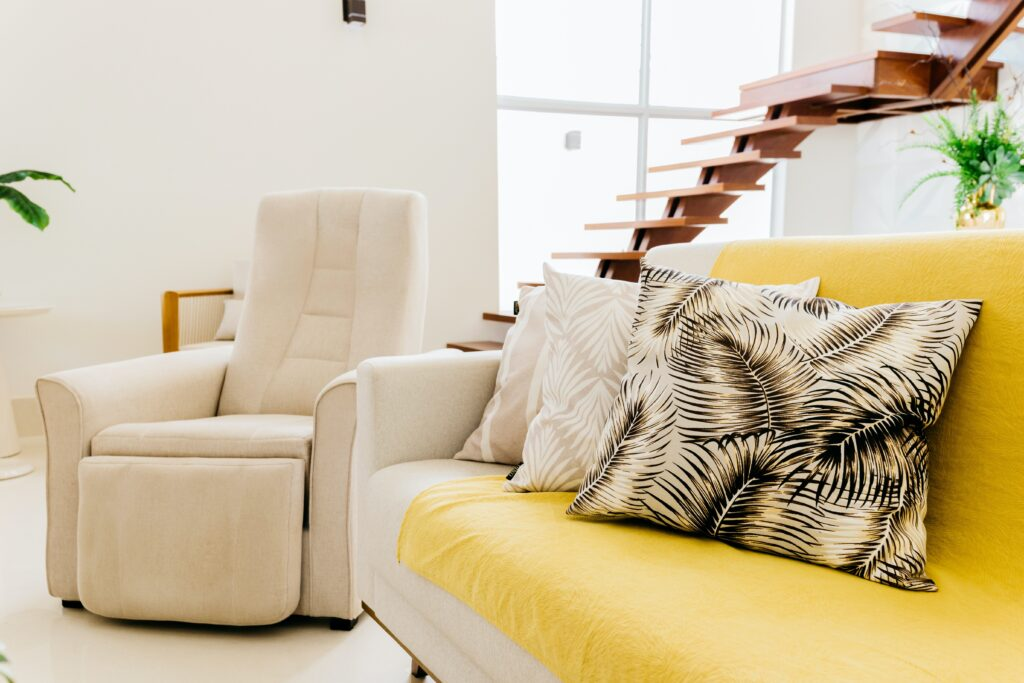 A comfortable chair with sofa and pillows