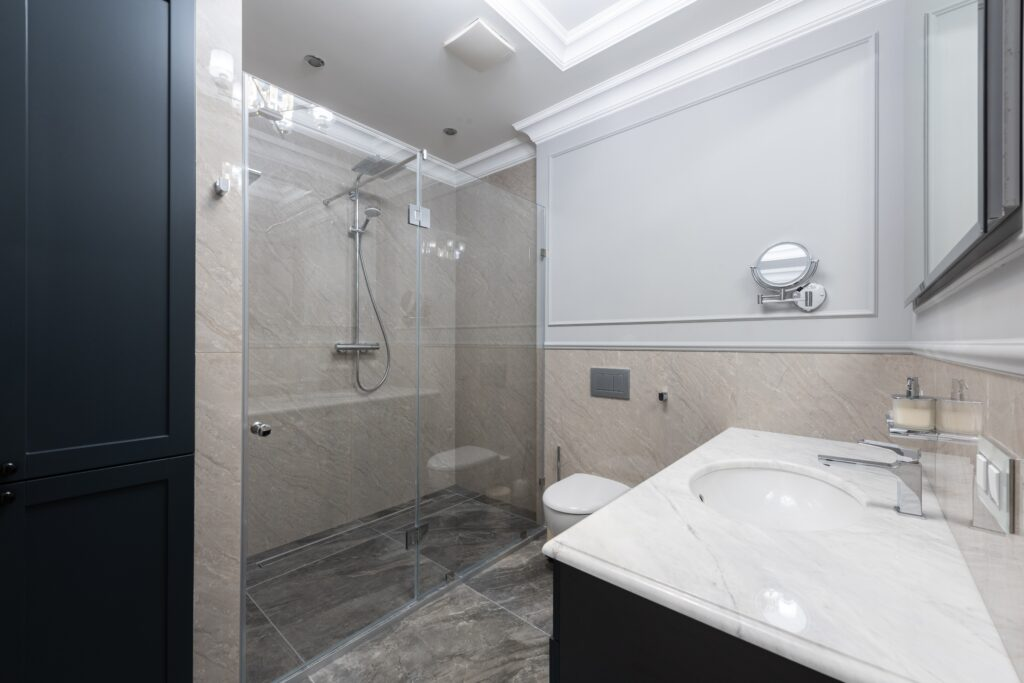 A bathroom with shower near the sink