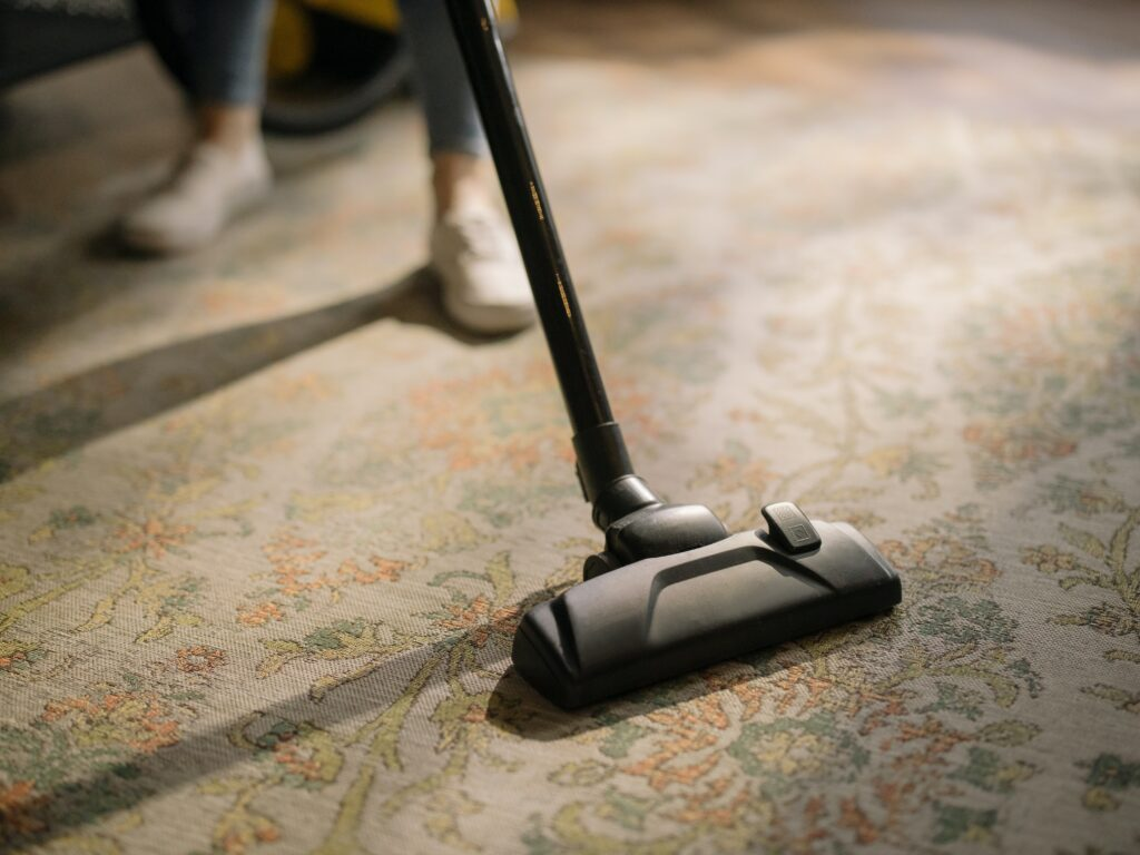 Cleaning the carpet with a vacuum cleaner