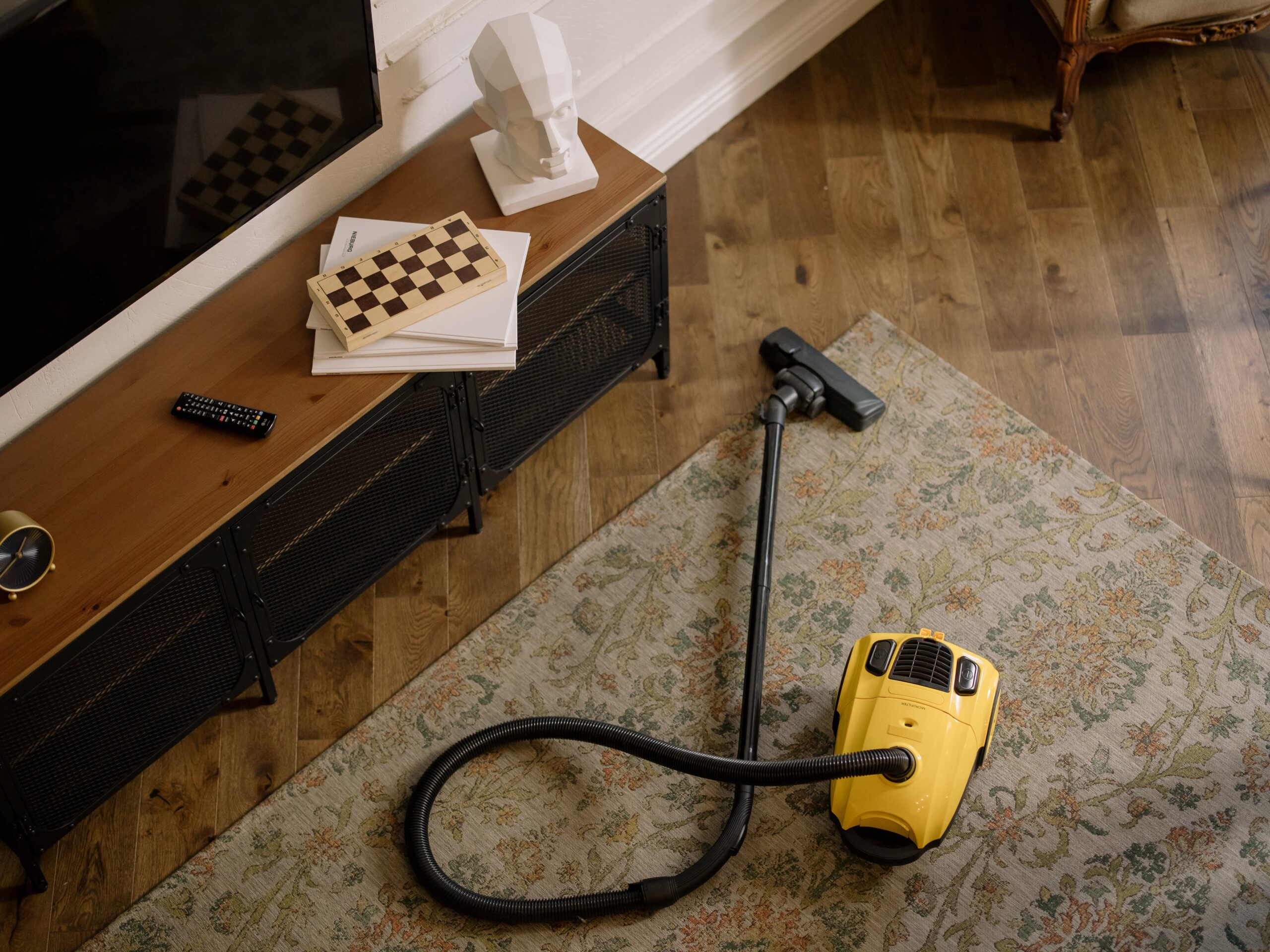 Yellow Vacuum cleaner on the carpet