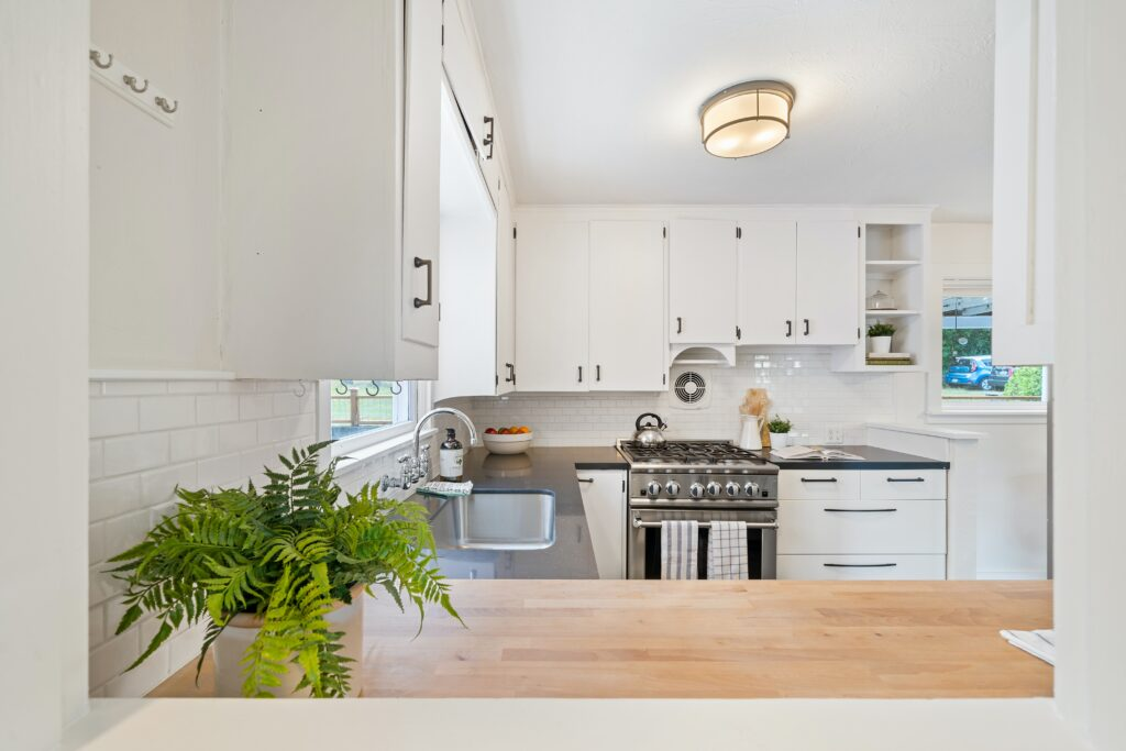 A kitchen area with a sink near the window