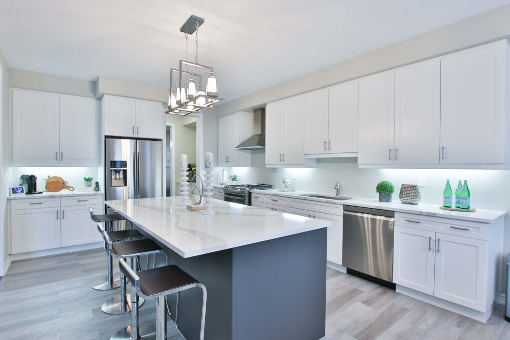 A white toned kitchen area with cabinets