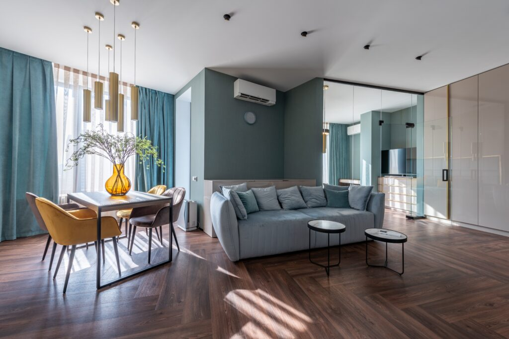 A blue green toned living room with sunlight