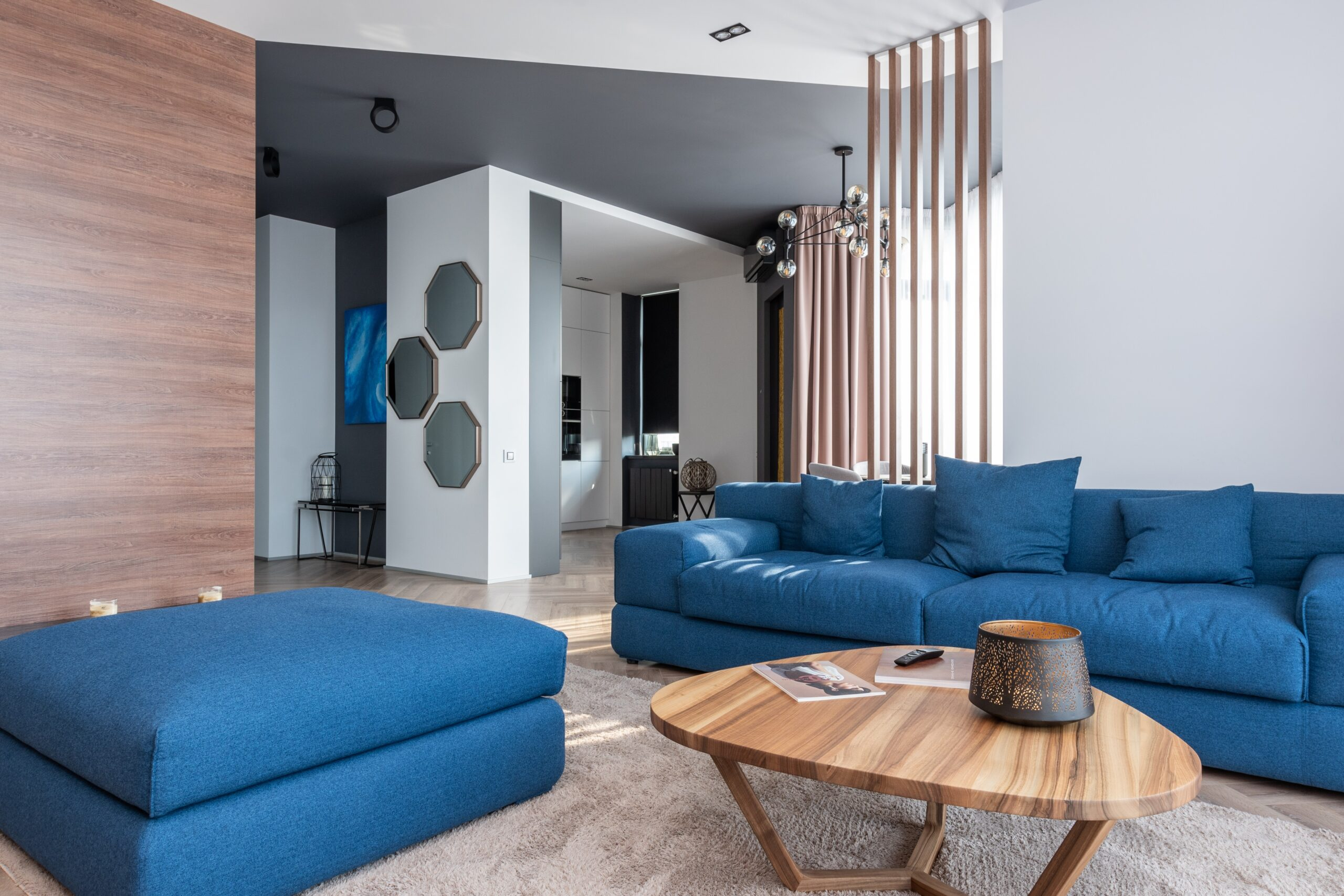 A blue colored sofa in the living room
