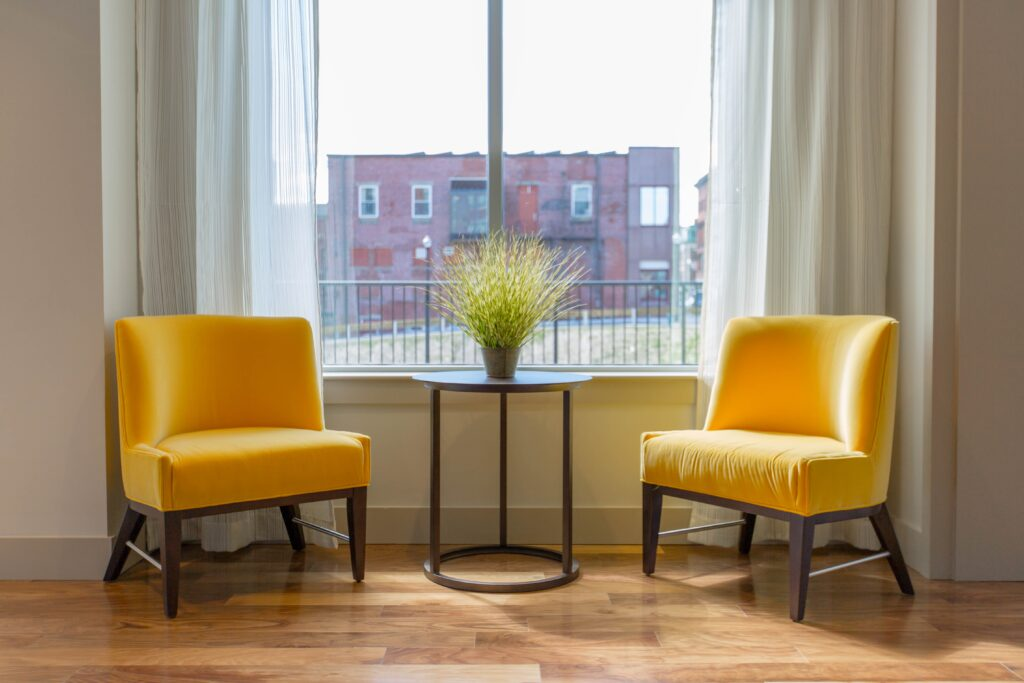Two yellow chairs near the window