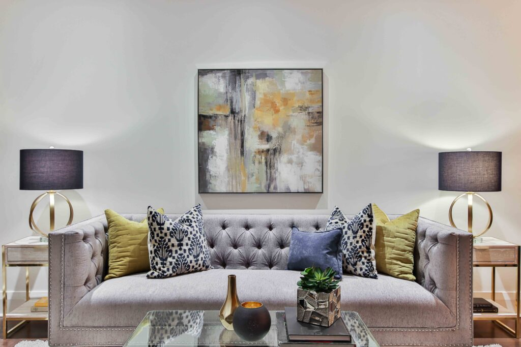 A gray sofa and a painting