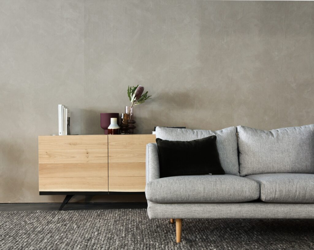 A gray sofa and a cabinet