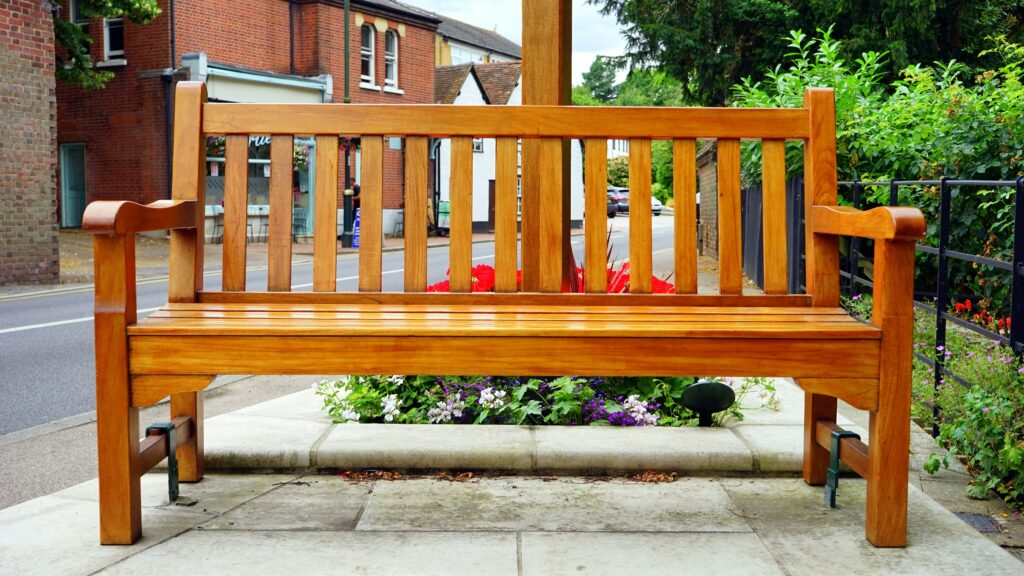 A shiny wooden bench