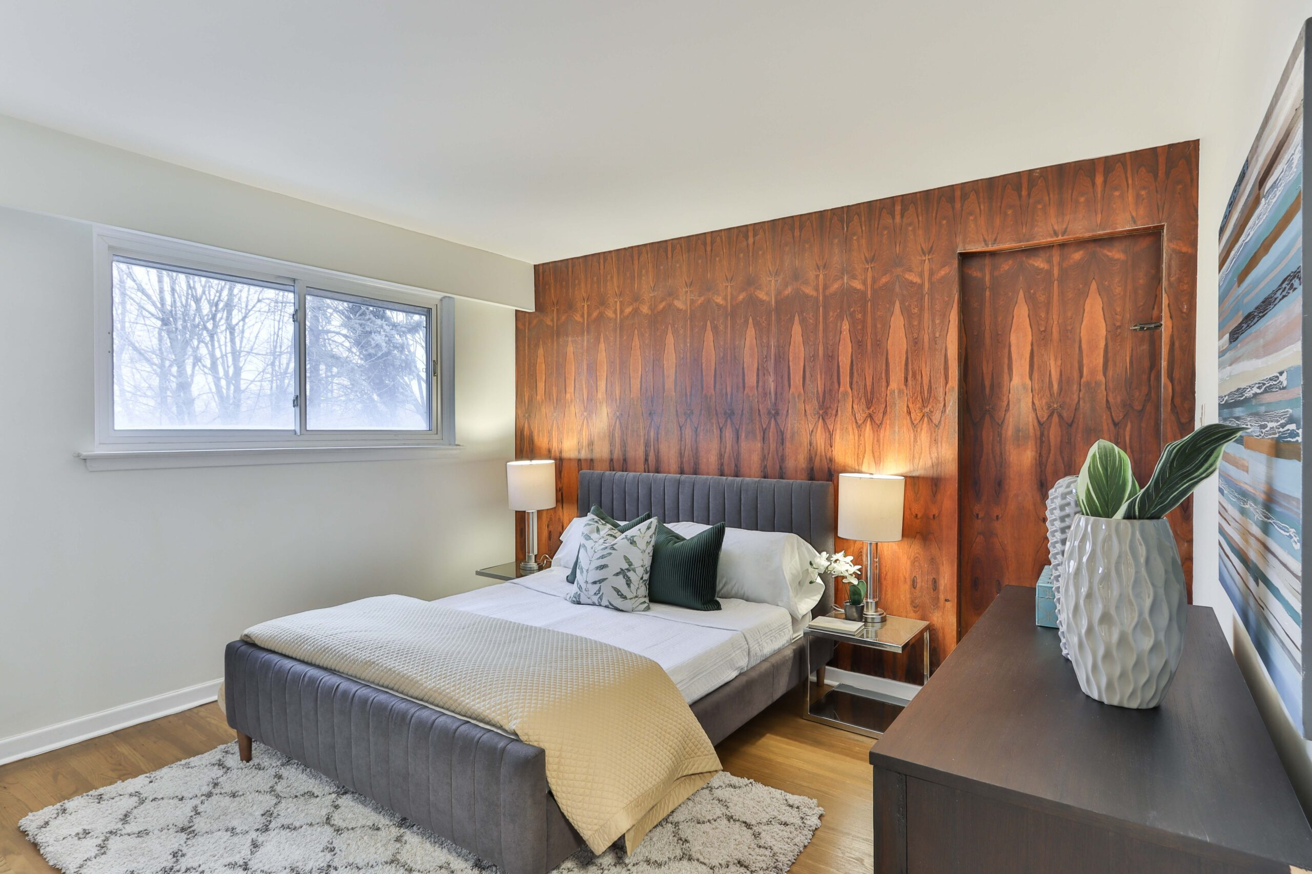 A bedroom with brown toned wallpapers on a wall