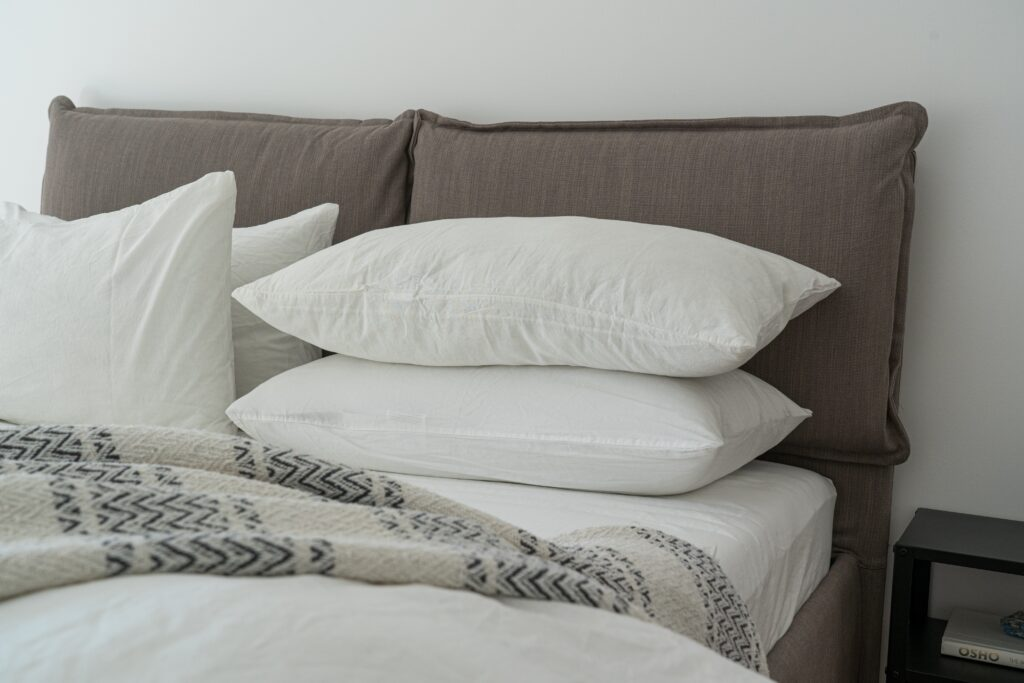Bed furniture with white pillows