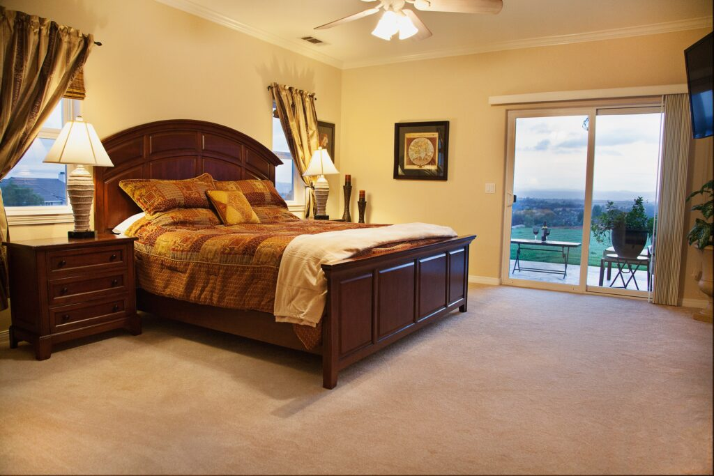 A brown toned bed furniture with bed sheets and distinct lights