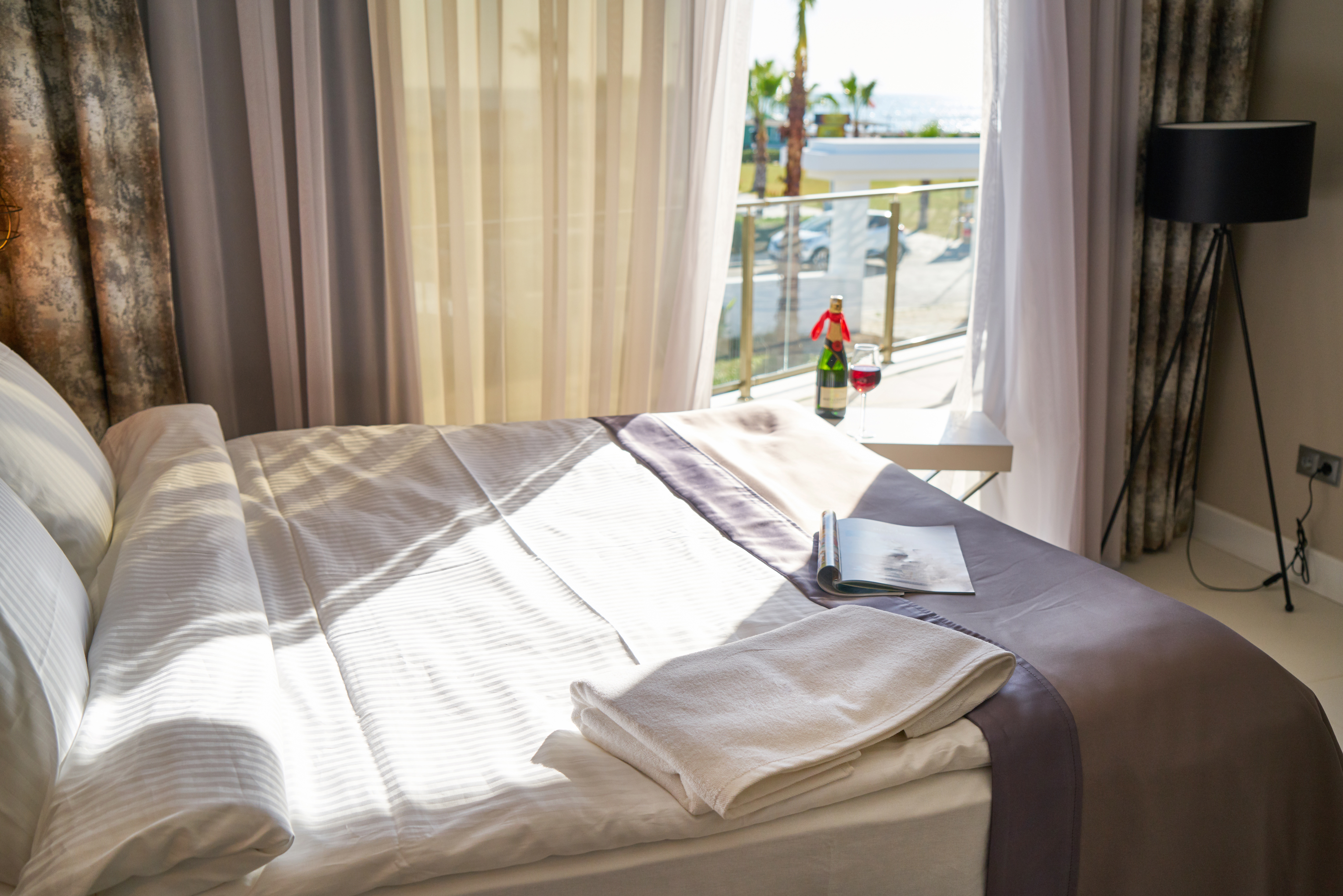 A bedroom with sunlight on bedsheets