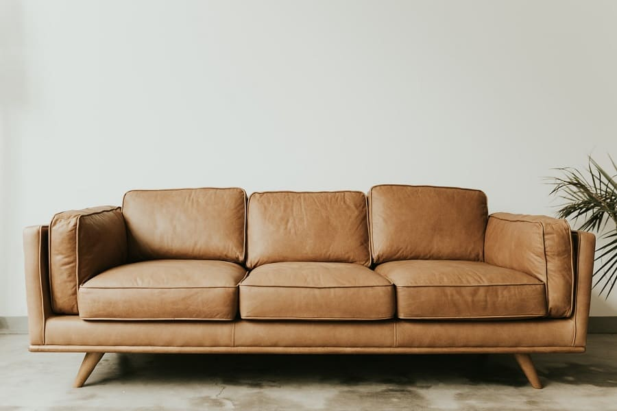 A three-seater brown leather couch