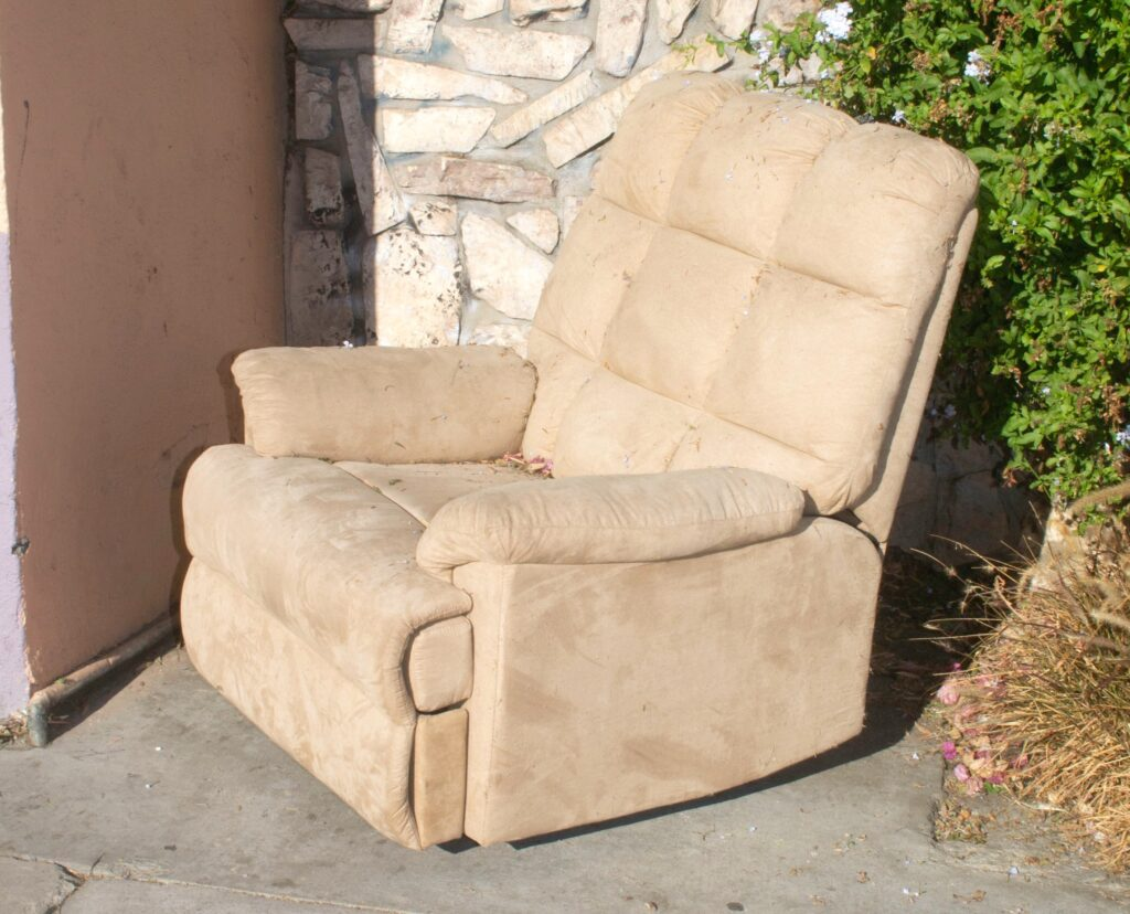 A white recliner on outdoors
