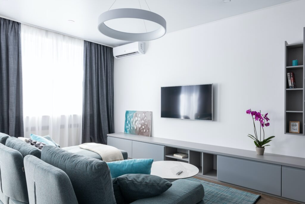 Living room with gray furniture and television