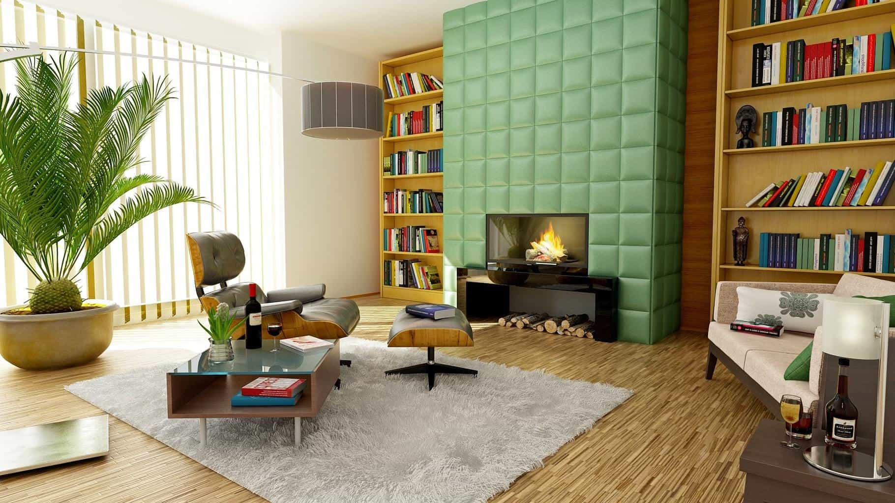 A living room filled with books and colored walls with a recliner and a fireplace