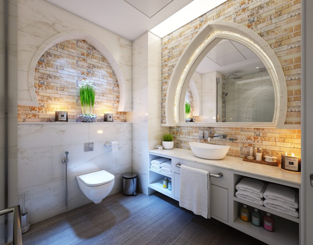 A vanity bathroom with a toilet bowl and lights