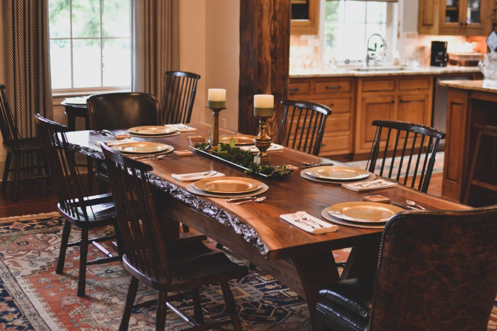 A wooden dining table with chairs