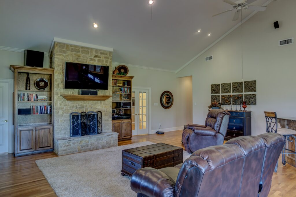 A recliner couch and recliner chair in a living room