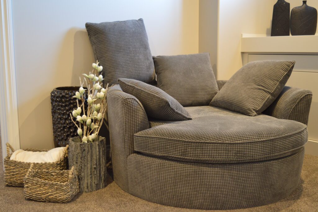 An accent chair with pillows