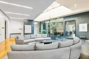 Gray fabric lazy boy sectional in a spacious living area