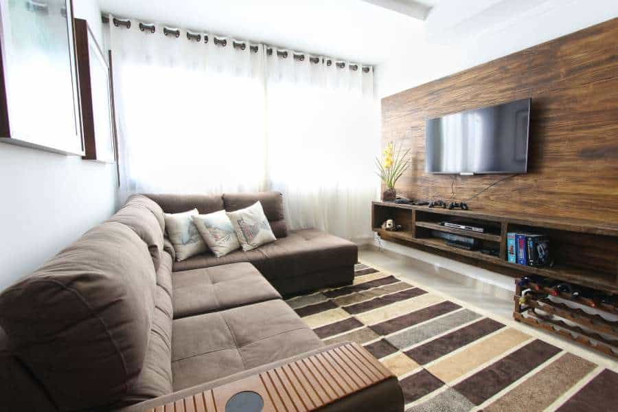 Brown fabric sectional in a TV room